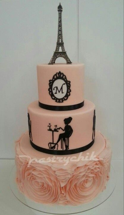 It's pink, it's a cake, it has my initial and it's topped with the eiffel tower