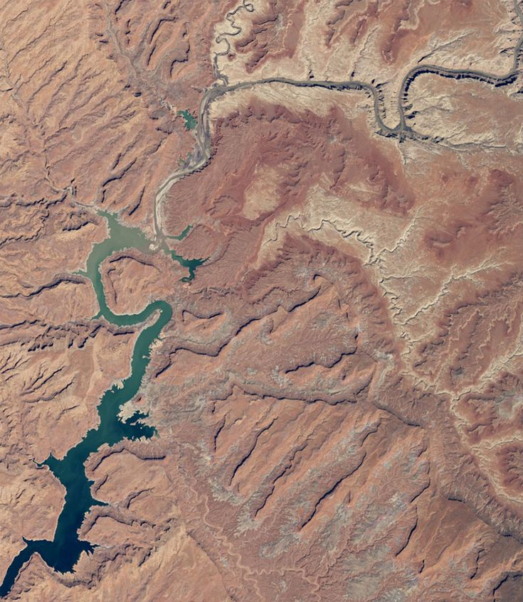 April 2015 – Choked by Drought:  Decreased snowmelt from the Rockies severely reduced water levels in Arizona's LAKE POWELL, affecting those who depend on it for water. Periodic droughts have become steadily more common. This year, the reservoirs were only at 45 percent capacity. - photo from NASA Earth Observatory ... Compare to a photo from 1999 ... Side-by-side comparisons reveal just how much glaciers, lakes, and snowpacks have been altered by nature and humans.