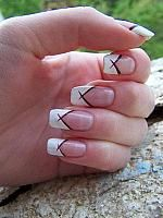 French manicure with red decorations