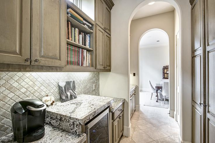 6638 Westchester West University Place, TX 77005: Photo Expansive butler's pantry with wine fridge and tremendous storage.