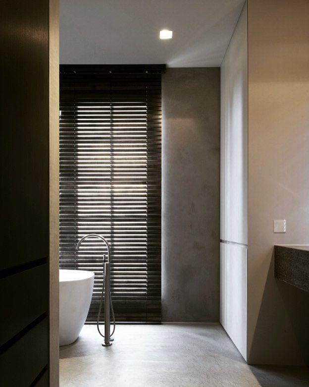 Modern bathroom with black blinds