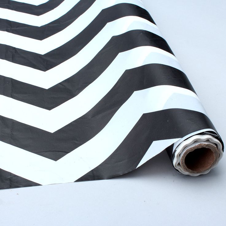"Plastic Chevron Tablecloth in Black and White 40"" x 100 ft Roll"