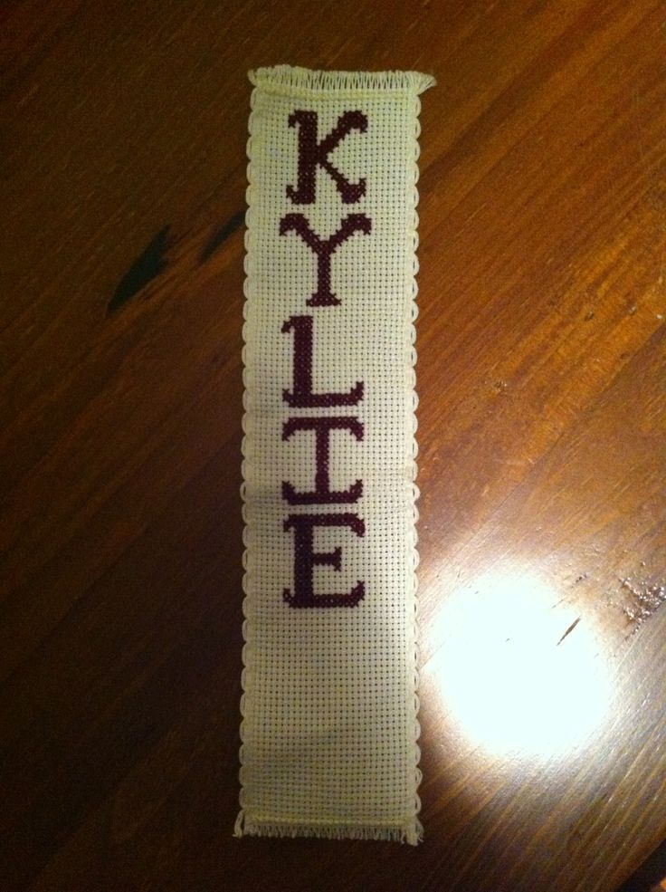 You can buy lengths of Aida made for bookmarks, then choose a nice alphabet sampler for a personalised bookmark.