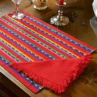 Cotton placemats and napkins, 'Ruby Fantasy' (set of 4) The bright colors of Guatemala are woven into a captivating set of placemats and napkins by the women of Komon Utzil. The pieces are worked on a traditional pedal loom, which requires the combined efforts of up to three people to set it up. The placemats feature the renowned jaspe patterns obtained from tie-and-dye techniques. $49.95 http://www.novica.com/itemdetail/index.cfm?pid=172481#
