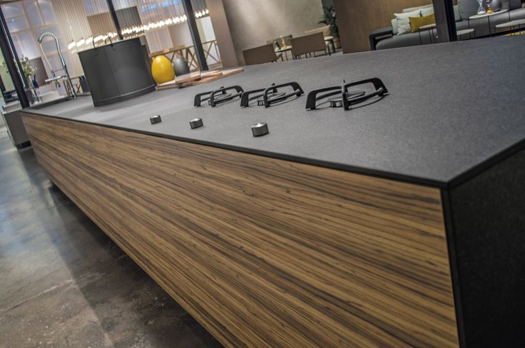 Spanish firm Inalco is experimenting with installing burners directly into the counter itself, which would eliminate the need for a separate cooktop. (Inalco, S.A.)