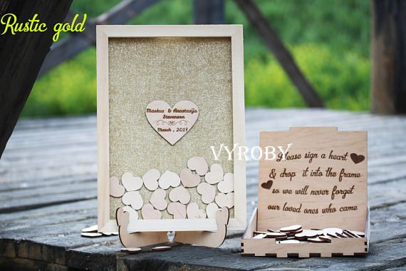 Welcome friends! This rustic wedding, birthday party guest book alternative drop top box natural framed sign with a wooden heart. Personalized burlap guestbook with your names. The exclusive guestbook is handmade for you. The set includes a personalized natural frame and small hearts. The sign and stand for wedding guest books can be purchased here: http://etsy.me/2rvlcRU The box for hearts and pen are here: http://etsy.me/2rPSJJF The picture shows the natural ...
