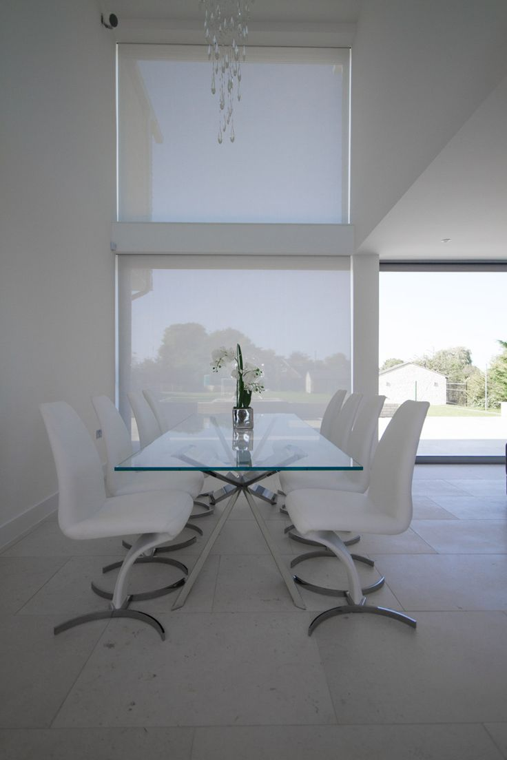 Contemporary kitchen table with automatic blinds concealed in Blindspace boxes.