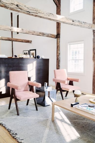 The must-visit summer pop-up in the Hamptons: Pink suede covered Pierre Jeanneret chairs in the living room.