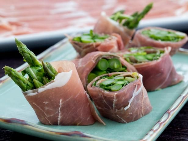 Get Prosciutto Rolls with Asparagus and Arugula Recipe from Cooking Channel
