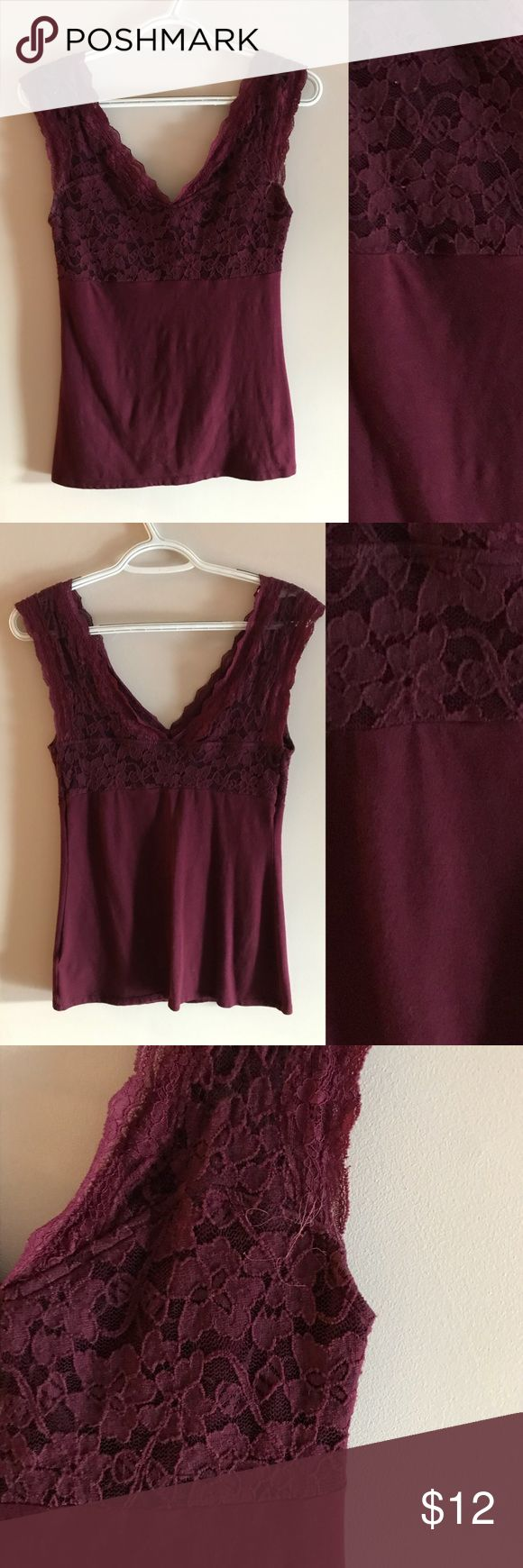 Maroon lace low cut tank top Medium express maroon low cut lace tank top Tight fitting Worn a couple of times good condition has some fraying on the front arm area from the dryer Really cute with a skirt or tucked into jeans Express Tops Tank Tops