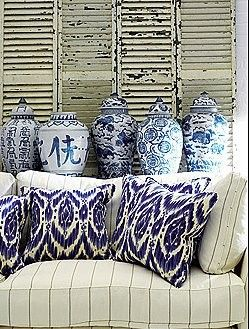 Ikat Pillows.......blue/white pottery....old shutters ..create a charming vignette...