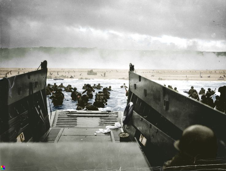 Omùaha Beach- 6 June 1944, Fox Green Sector, Company E, 16th Infantry, 1st Infantry Division moves ashore from a US Coast Guard LCVP from the U.S. Coast Guard-manned USS Samuel Chase. On the bluffs is the German 352.Infantrie-Division. E Company was to storm the beach and clear Exit 1. In the center of the beach is Sherman DD number 9 from the 741st Armored Battalion which was supporting the assault.