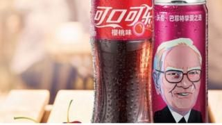 Image copyright                  Coca-Cola               Billionaire investor Warren Buffett's face is appearing on promotional packs of Cherry Coca-Cola in mainland China.  Mr Buffett is frequently pictured in public drinking Cherry Coke, and his investment firm...