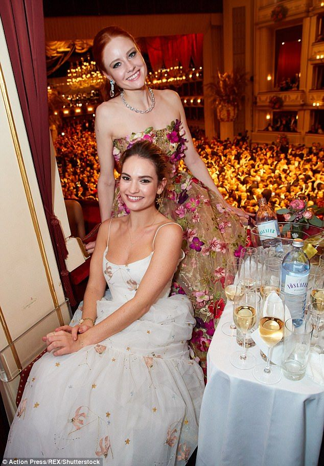 Stunning: Lily looked a picture of glamour in a floor-length white gown and gold jewellery, and the 28-year-old was beaming as she attended the glitzy event