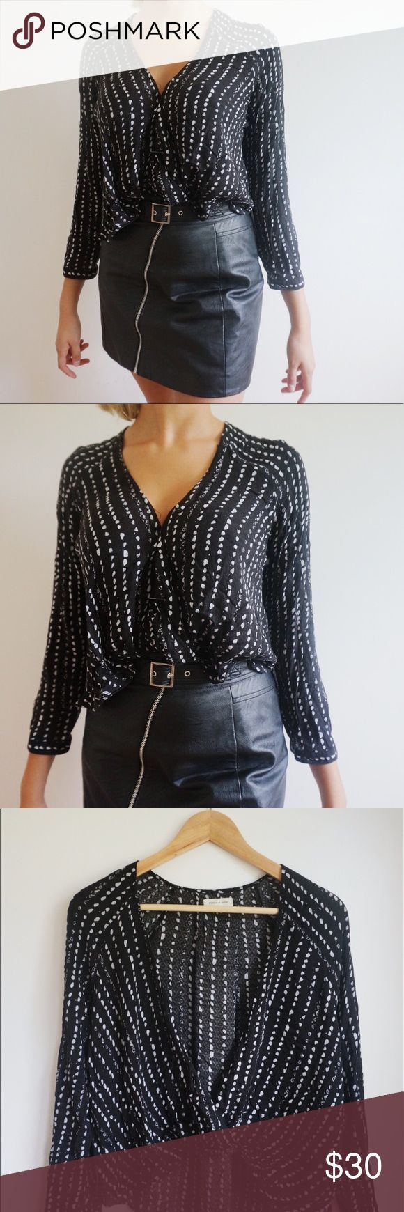Urban Outfitters open front shirt 🌟 This shirt is great for my ladies on the smaller bust side - and the open front is a perfect way to display those lacy bralettes 😻 It's very lightweight and perfect for the summer // SIZE: MEDIUM GOOD CONDITION Urban Outfitters Tops Tees - Long Sleeve