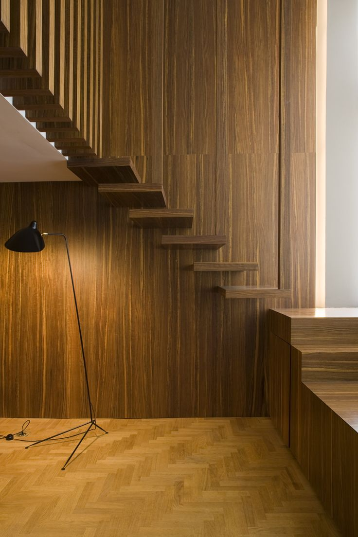 Wooden staircase by Belgian office Co.studio.