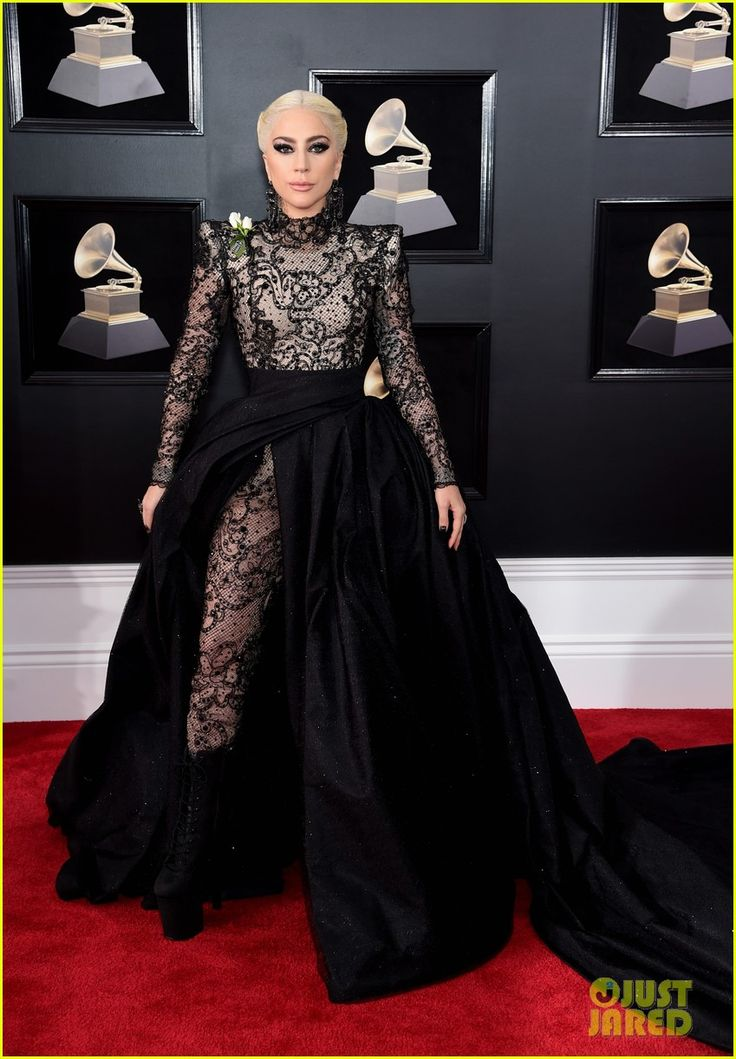 2018 Grammys: Lady Gaga is wearing a black Armani Prive gown with a sheer bodice and long train. I love the mix of Gothic and glam! Glam with the sparkle and Gothic with the edge! I love the edgy braid too! This is one hundred percent a Gaga look! Best Dressed!