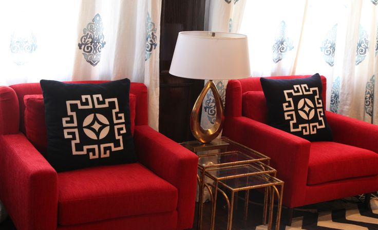 Custom and comfy red chairs as a pop of colour accented with KTH Smythe Medallion Pillows