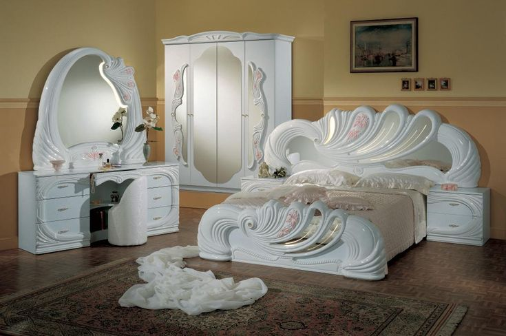 The Vanity White Italian Classic Bedroom Collection features rich white swan…