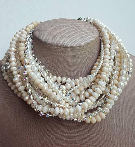 Check out this item in my Etsy shop https://www.etsy.com/ca/listing/532816915/multistrand-blush-pearl-crystal-boho