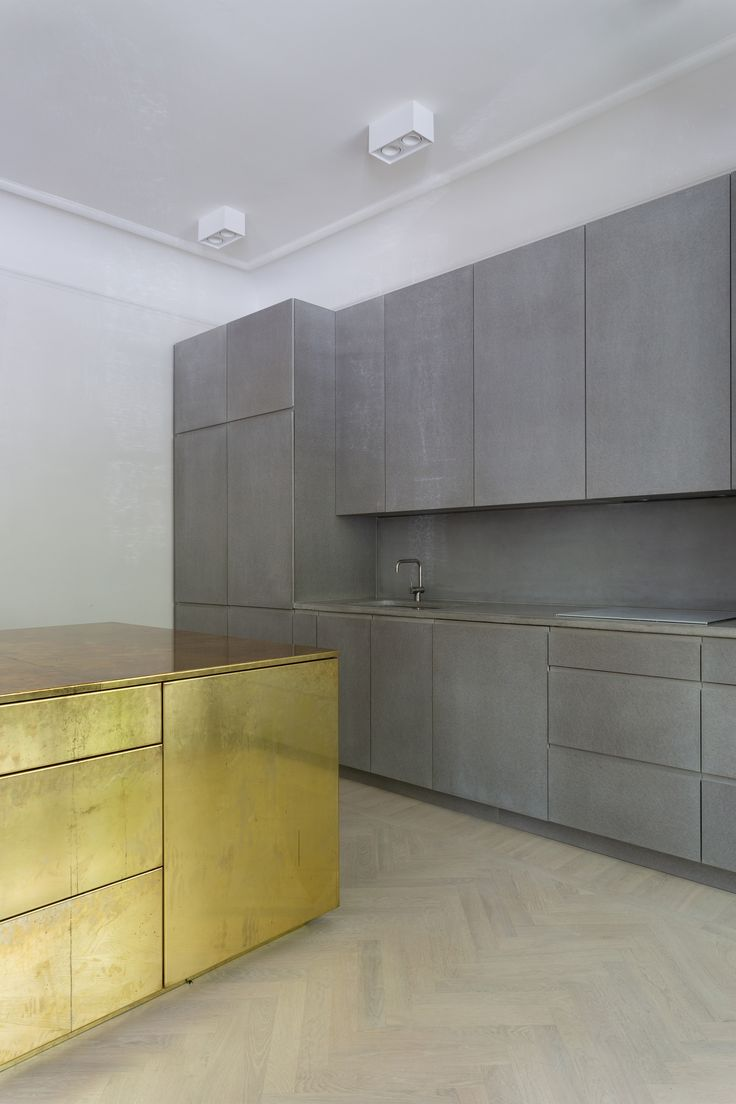 Gold and brass fixtures and faucets promising or passe apartment - Gold Grey Apartment Richard Lindvall