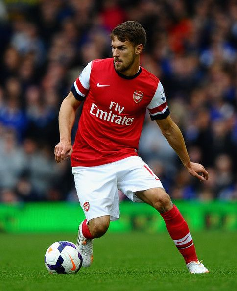 Aaron Ramsey Photos - Aaron Ramsey of Arsenal  in action during the Barclays Premier League match between Everton and Arsenal at Goodison Park on April 6, 2014 in Liverpool, England. - Everton v Arsenal - Premier League
