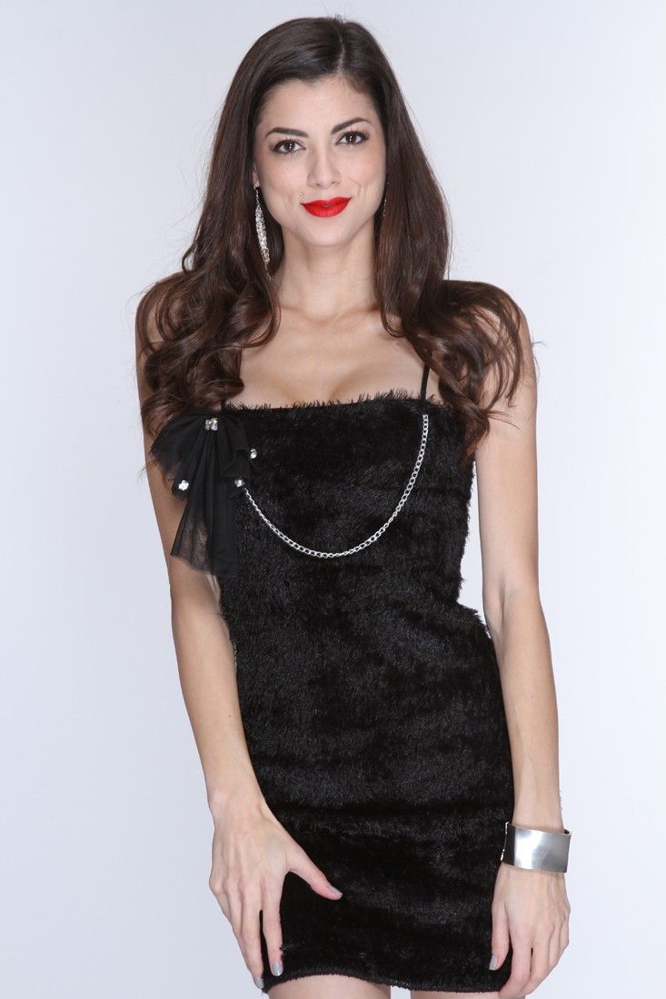 This captivating dress will have you party-ready in no time! With its fashion-forward look, it will make you stand out among the rest. It features a faux fur material, adjustable spaghetti straps, a removable chain-link detail with a jeweled mesh bow, and full lining. 96% Polyester/4% Spandex. Model is wearing a Small.