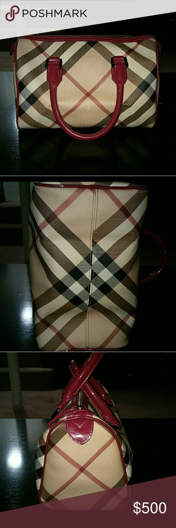 Burberry bowling bag Beautiful original checker print Burberry bowling bag with redish pink handles. Super clean. Absolutely no marks, scuffs, scratches, or dirty. Used twice. 100% authentic. comes with dust bag. Burberry Bags
