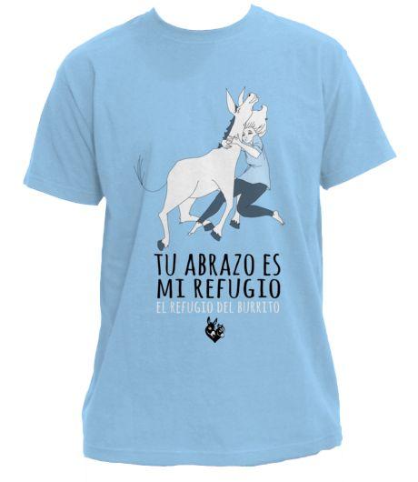 """""""En El Refugio del Burrito lanzamos esta campaña de venta de camisetas, con el fin de recaudar fondos para continuar rescatando burros y mulos en toda España. Con un diseño exclusivo de Ángela Romero (www.ferostica.com) y bajo el lema 'Tu abrazo es mi refugio', buscamos promover un bienestar que se extienda de los burros a otros animales y a los propios seres humanos. Porque todos merecemos amor y respeto."""" Cortesía de El Refugio del Burrito, Fuente De Piedra, Málaga (España)."""""""