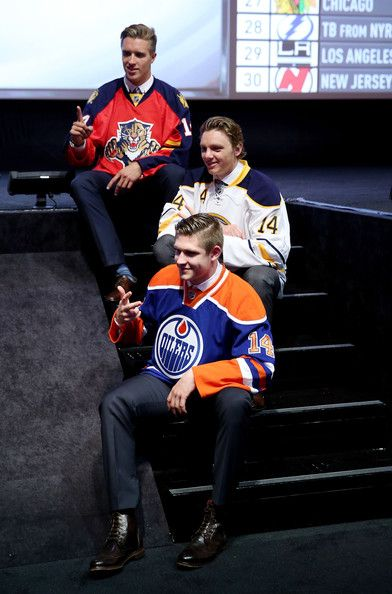 Leon Draisaitl Photos Photos - (Front to back) Leon Draisaitl third overall pick by the Edmonton Oilers, Sam Reinhart the second overall pick by the Buffalo Sabres, and Aaron Ekblad first overall pick by the Florida Panthers pose during the first round of the 2014 NHL Draft at the Wells Fargo Center on June 27, 2014 in Philadelphia, Pennsylvania. - NHL Draft: Round 1