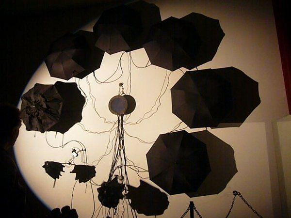 Black umbrella installation set to music