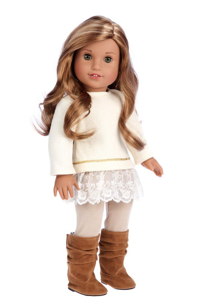 Ivory cotton tunic with embroidered lace and gold ribbon matched with beige leggings and brown suede boots.     Doll outfit contains a wide back closure for easy dressing and clothing removal. Our doll clothes fits 18 inch American Girl dolls. Designed in the USA and sold Exclusively by DreamWorld Collections. DOLL(S) NOT INCLUDED U.S. CPSIA CHILDREN'S PRODUCTS SAFETY CERTIFIED