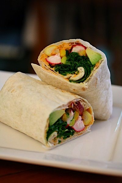 Crunchy Spicy Hummus Wraps  Makes 6 sandwiches    Ingredients  1 avocado, mashed  1/2 lemon, juiced  1 cup chipotle hummus  6 medium tortillas  2 cups sliced radishes  3 medium carrots, peeled, and cut into 4-inch match sticks  1/4 lb baby arugula