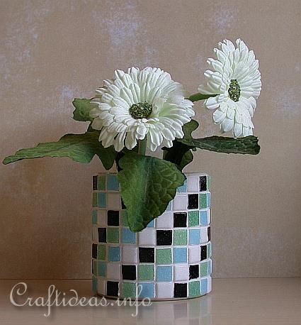 Recycling an old can:  - tin can  - small mosaic tiles in colors of choice (you can also use broken pieces of ceramic or porcelain)  - grout mixture  - mosaic or jewel glue