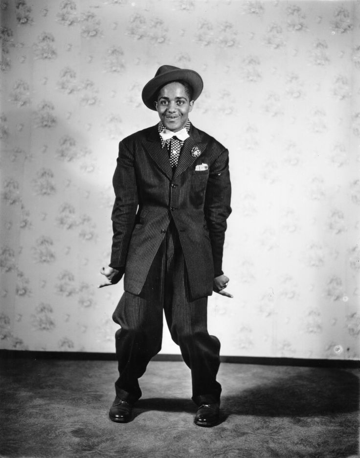 Zoot Suit. An extreme form of the sack suit, the jacket was long and wide with lapels where the pants were pegged. This style is said to have originated at the lower end of the socioeconomic ladder.