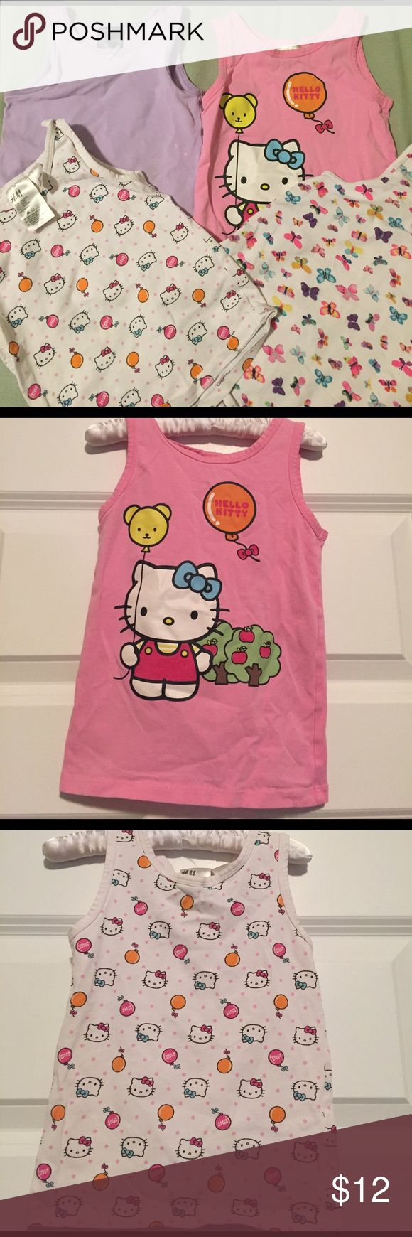 Lot of 4 H&M Sleeveless Tees/Undershirts Lot of 4 H&M Sleeveless tees / undershirts. 2 are Hello Kitty, 1 with butterflies, 1 lavender. Shows wash wear and lavender has bleach stains as shown in photo. Stretchy cotton/elastane. Name in sharpie on tag or back trim. H&M Shirts & Tops Tank Tops