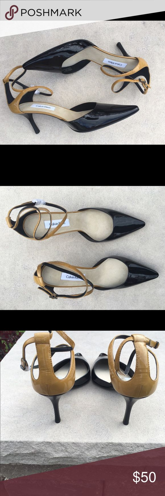 """Calvin Klein Patent Leather Ladies Pump. Top off your polished modern look in these adorable Calvin Klein black/brown patent leather pump! The color is Sandstorm/Black.  Heel height is approximately 2 1/2"""".  Never worn. Calvin Klein Shoes Heels"""
