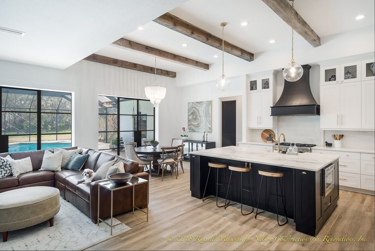Black and white kitchen with reclaimed beams for this whole home remodel in Brandon, Florida.