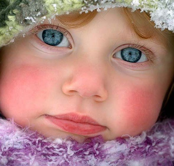 Wow.  Photo of child in winter with amazing eyes