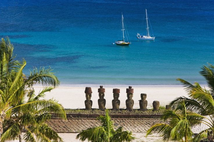Anakena beach, yachts moored in front of the monolithic...