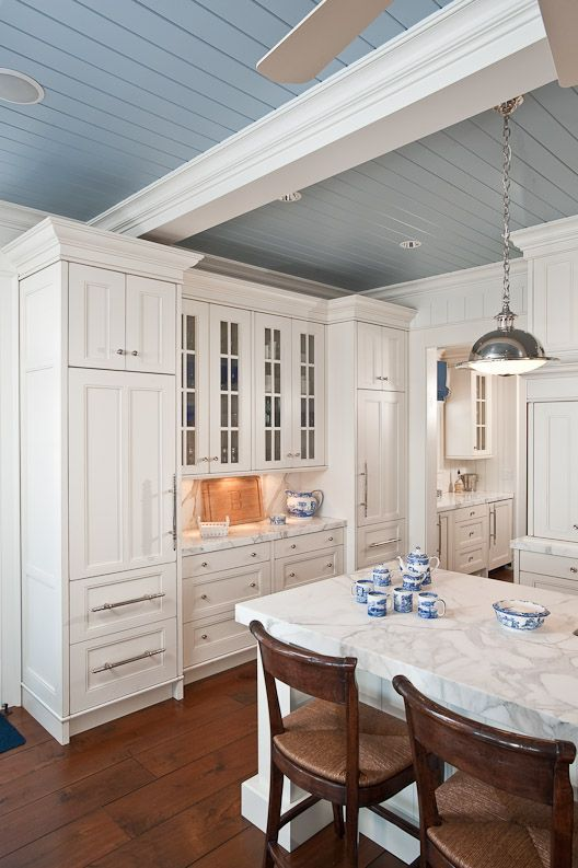 Coastal kitchen with blue painted ceiling