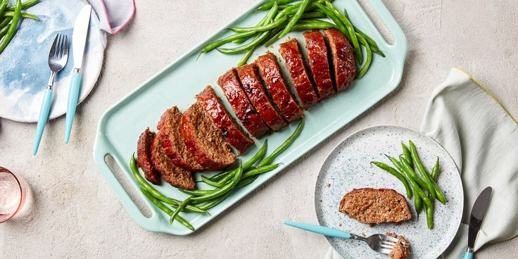 This ultimate meatloaf recipe took rounds and rounds of testing to get just right. Our final version incorporates an ideal blend of seasoned ground beef and pork, aromatics, and breadcrumbs and bakes in a freeform loaf on a baking sheet instead of in a loaf pan for maximum browning. The result is a loaf that is savory, tender, and juicy, yet holds together well when sliced. It's perfect warm or served cold in a meatloaf sandwich.