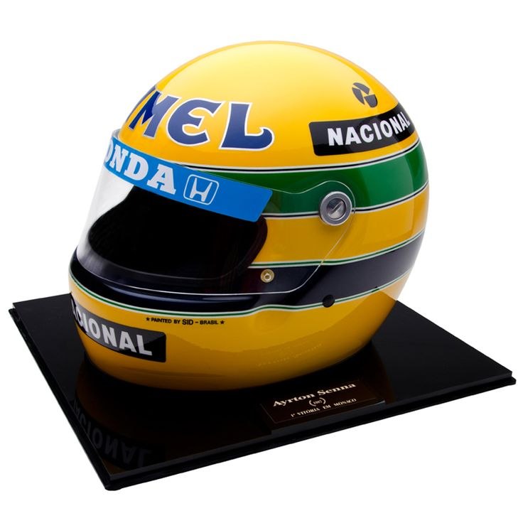 Ayrton Senna was racing for Camel Team Lotus Honda in 1987 and finished third in the Formula One World Championship collecting 57 points throughout the season. This helmet was designed by Sid Special Paint, the same manufacturer who produced Ayrton Senna`s helmet throughout his racing career. The helmet is a full size helmet and strictly limited edition and comes complete with a certificate of authenticity.