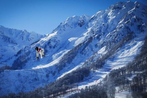 U.S. snowboarder Sage Kotsenburg goes off a jump during snowboard slopestyle training at the 2014 Sochi Winter Olympics in Rosa Khutor, February 3, 2014.