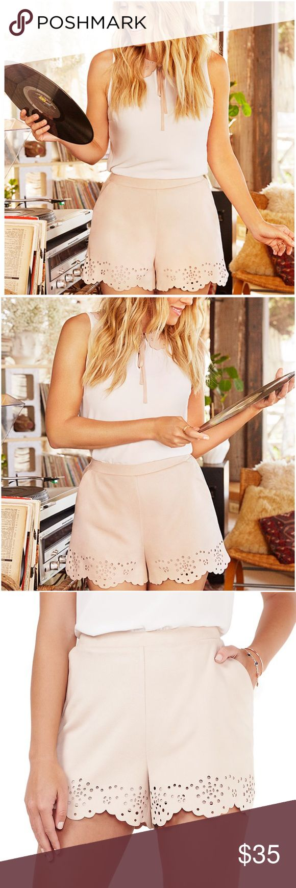 """LAUREN CONRAD Blush Pink Faux-Suede Eyelet Shorts NWT LC LAUREN CONRAD super soft blush pink scalloped faux-suede eyelet shorts will elevate your warm weather wardrobe!  The scalloped eyelet hem adds a sophisticated touch to your casual style.  XS 0-2 (27"""" waist), S 4-6 (29"""" waist), M 8-10 (31"""" waist), L 12-14 (34"""" waist), XL 16-18 (37"""" waist) Scalloped hem with eyelet details 2 front pockets Faux-suede Lined 3 1/2-in. inseam Midrise sits above the hip Elastic waistband Polyester Machine…"""