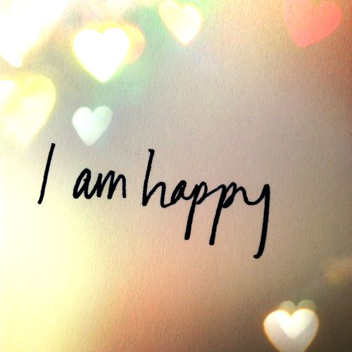 I am happy. lovely picture / photo with hearts bokeh style. Words. Quotes