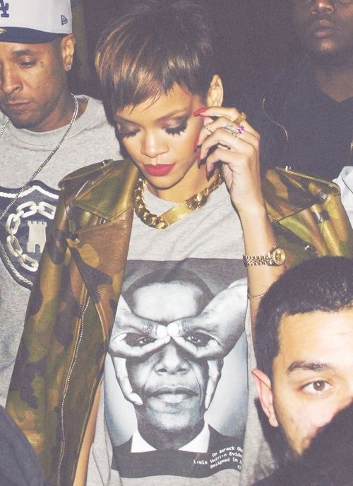 Rihanna wearing Obama doing the satanic 666 eyes.