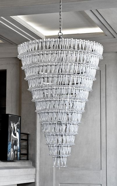 A Gigantic Chandelier Made Of Flutes Specially Formed Champagne Gl Welcomes All