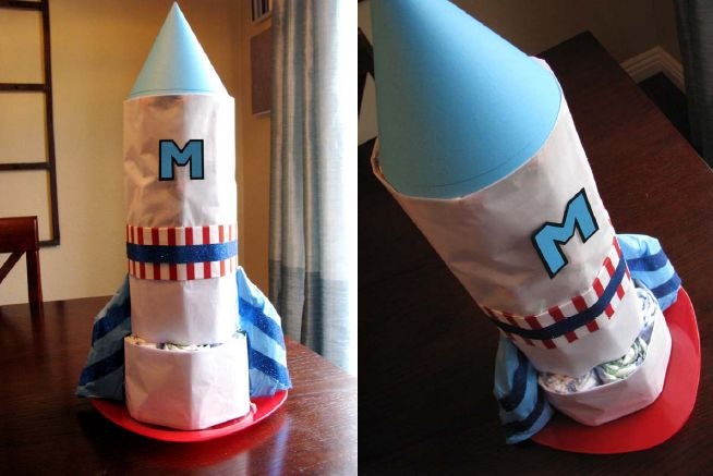 3, 2, 1... Liftoff!!! I'm planning a space-themed baby shower for a co-worker and thought it would be super cool to make a unique diaper cake in the shape of a rocket. I've never made one before so...