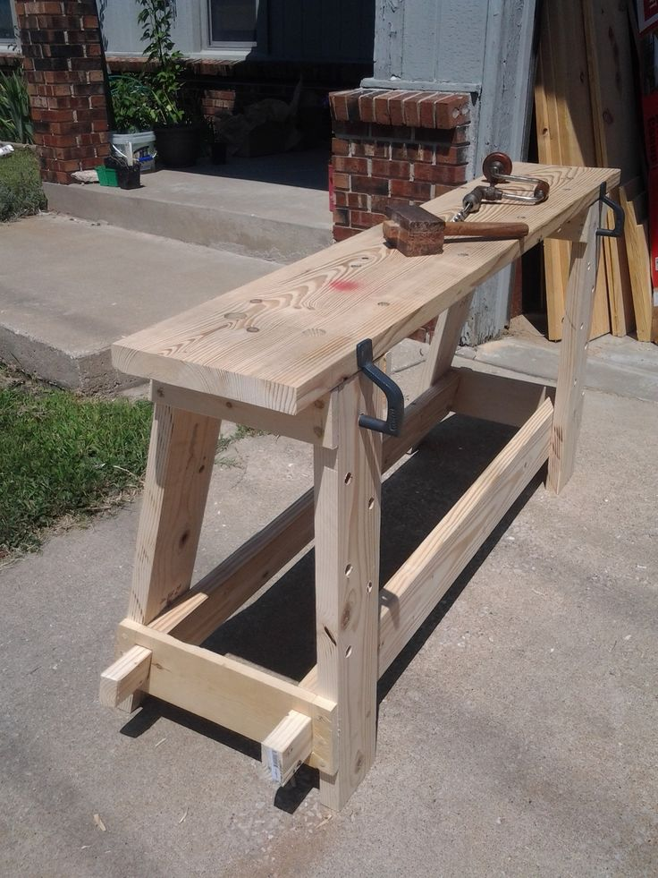 My portable workbench.  It disassembles into the top, two leg assemblies, and the two stretchers.  Based on a historical example from the 1300's.